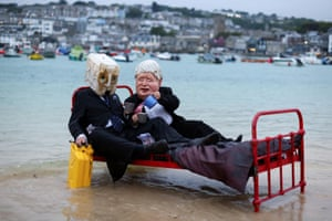 Activists from the climate action group Ocean Rebellion demonstrate in St Ives harbour