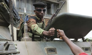 Euphoric crowds greet armed soldiers