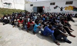Illegal migrants sit in Abu Saleem detention centre in Tripoli.