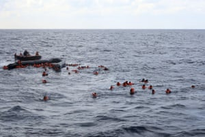 Refugees and migrants are rescued after leaving Libya to try and reach European soil aboard an overcrowded rubber boat in the Mediterranean.