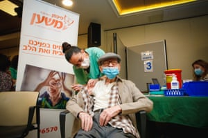 The Covid-19 vaccination is admiisterd at a care home in Israel