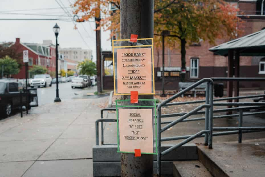 Coronavirus warnings are posted outside the Allentown Area Ecumenical food bank.