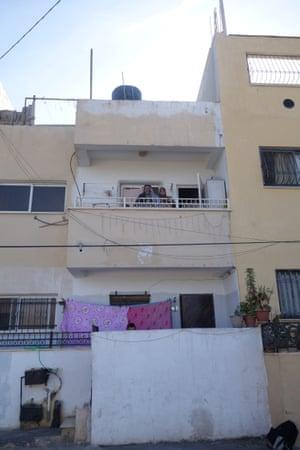 Ibrahim Mahmoud Saleh, on the balcony of his new apartment