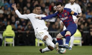 Casemiro tries to dispossess Lionel Messi during Real Madrid's 2-0 win over Barcelona in early March that set them on the way to another La Liga title.