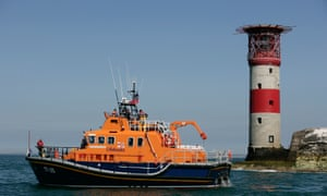 Sailing by: an RNLI Lifeboat on standby near the Needles Lighthouse off the Isle of Wight.