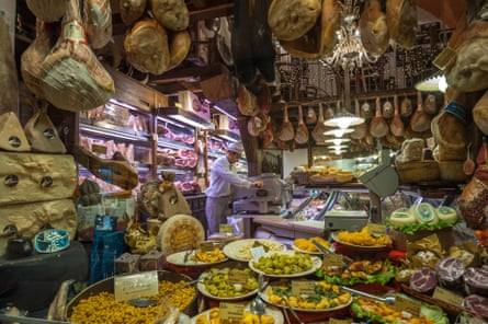 Window of typical grocery shop in Bologna