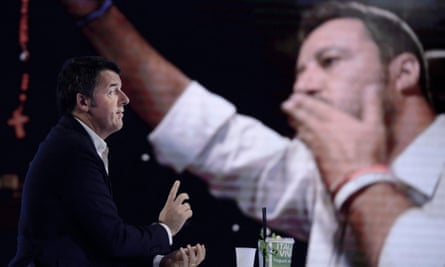 Matteo Renzi in front of a screen with the image of Matteo Salvini