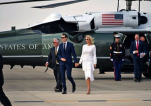 Jared Kushner and Ivanka Trump make their way to board Air Force One before departing from Ben Gurion airport in Tel Aviv.