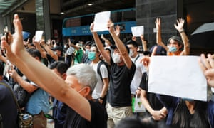 Hongkongers raise blank papers after slogans were banned.