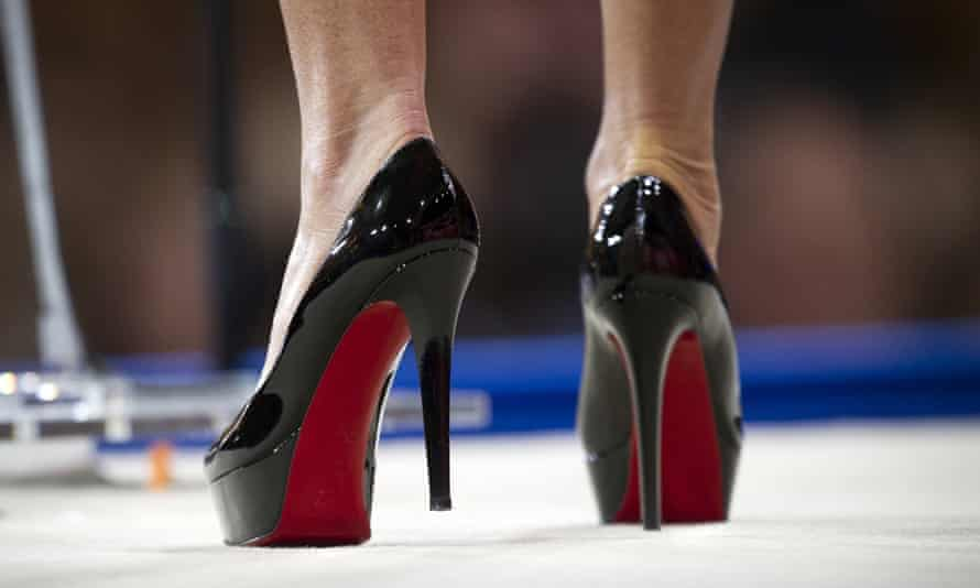 Pair of Christian Louboutin red-soled shoes