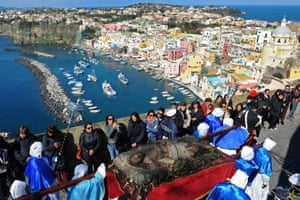 A wooden statue of Christ is paraded through the street on the island of Procida, Italy