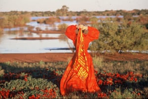 Nell Schofield wearing Jackson's Bush Couture outfit with a Sturts Desert Pea scarf, at Lake Menindee, 1984.