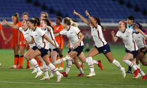The USWNT celebrate following their team's victory in the Olympic penalty shootout against the Netherlands