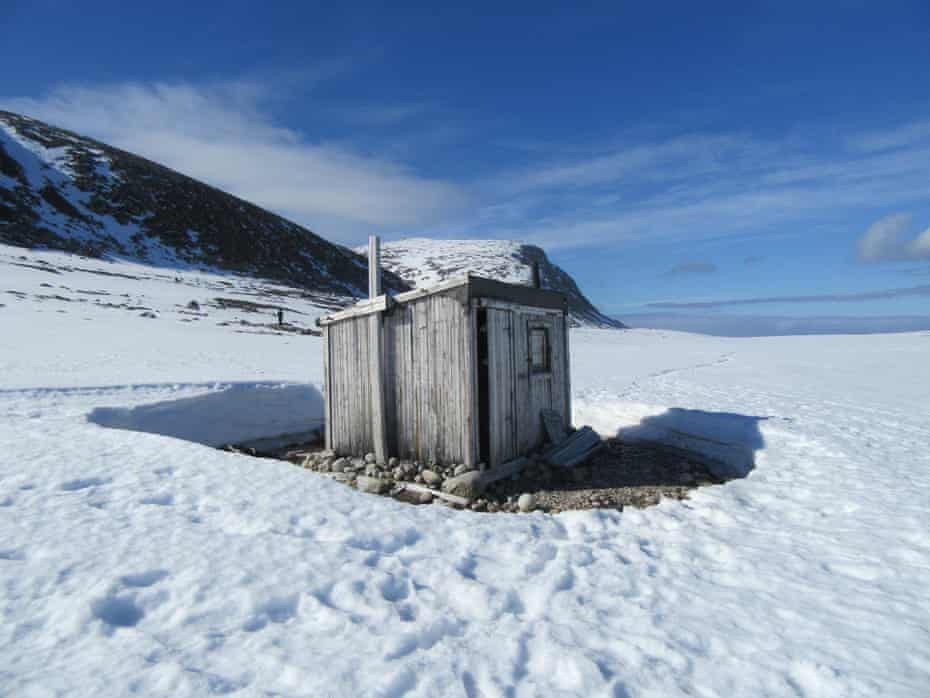 'Solitary specks in the vast landscapes': a cabin on Svalbard.