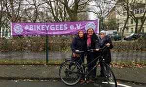 Annette Krüger, co-founder of Bikeygees (centre), with Rahima on the right, who wasn't allowed to cycle before she came to Berlin.