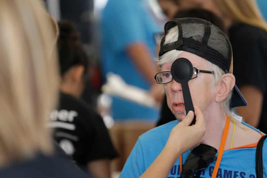 """An athlete gets a free eye exam in """"olympic town"""" at the Indiana Special Olympics."""