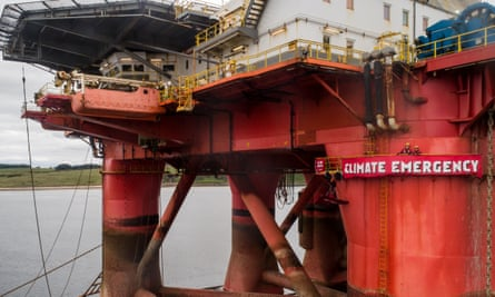 Greenpeace climbers demonstrate on BP oil rig in Cromarty Firth, Scotland