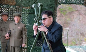 Kim Jong-un watches a submarine-launched missile test on 24 April.