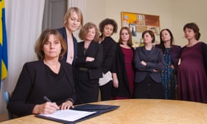 Isabella Lovin, left, then the deputy PM, with female colleagues signing a climate change bill – the photo went viral on Twitter.