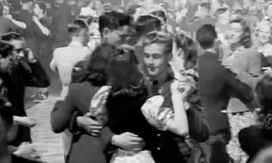 Soldiers and civilians dance in a scene from Listen to Britain