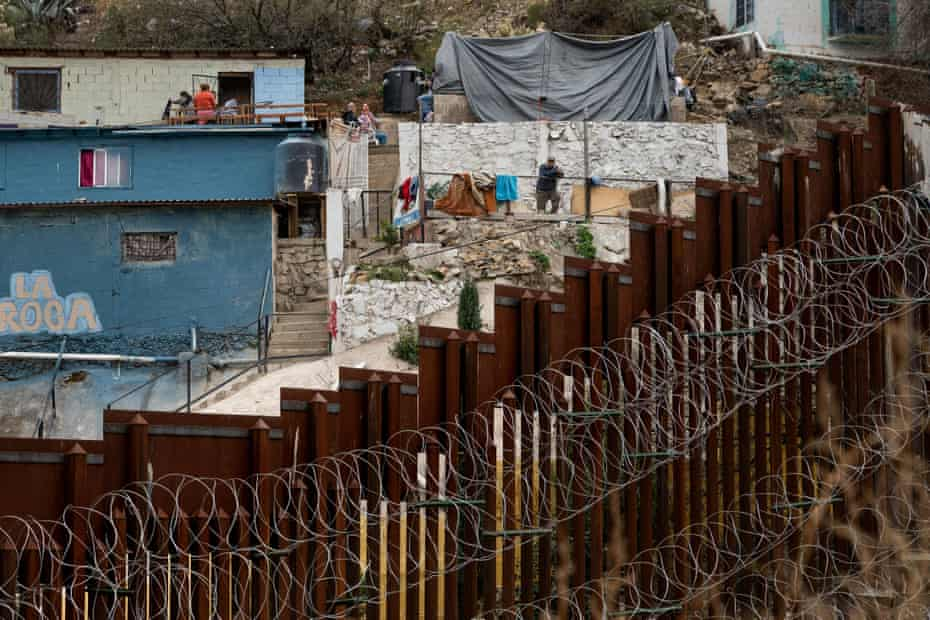 Photographs by Ariana Drehsler showing a man looking at the US/Mexico border fence from Nogales, Arizona, on February 9, 2019.