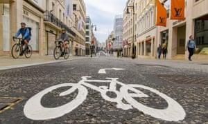 Cyclists in New Bond Street, London, as the coronavirus lockdown continues
