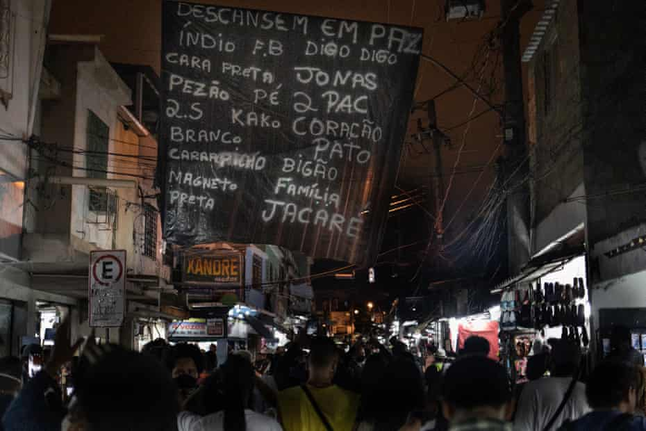 Many of the victims appear to have been involved in the drug trade. Their nicknames are spray-painted on to black plastic banners that now hang over Jacarezinho's main streets.