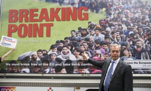 Nigel Farage with the poster