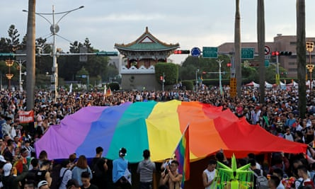 Participants hold a giant rainbow flag as they take part in LGBT pride parade in Taipei in 2017