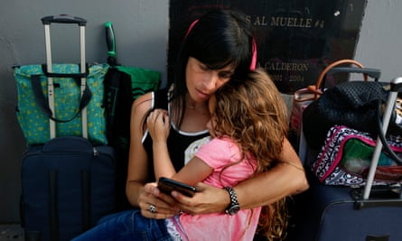 Solymlar Duprey holds her daughter Miabella as they try to get on an evacuation cruise ship leaving San Juan.