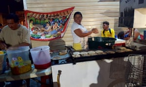 The busiest nighttime food stall near the swing bridge in Belize City is run by a Salavdoran couple making the national dish, pupusas.