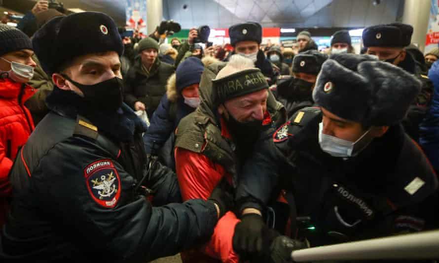 Police officers restrain man