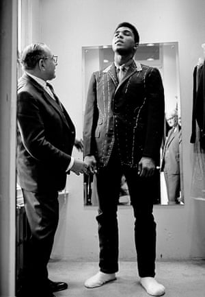 Muhammad Ali (then Cassius Clay), boxing world heavyweight champion, being fitted for a new suit, London 1966