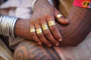 Baiga girl shows her rings and tattoos
