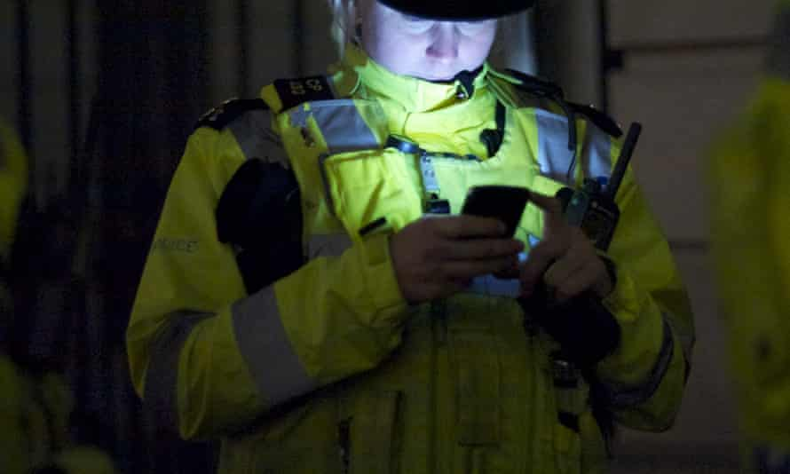 A police officer with a mobile phone