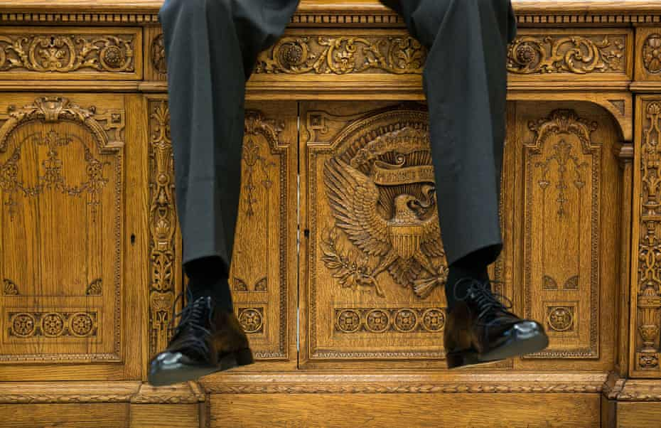 Seat of power … Barack Obama uses the Resolute desk to take the weight off.