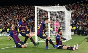Barcelona's Lionel Messi celebrates scoring their third goal with Sergi Roberto, Luis Suarez and Sergio Busquets.