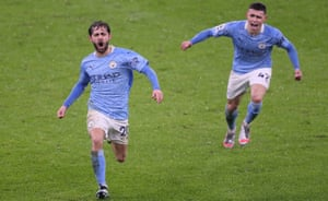 Bernardo Silva (left) celebrates his goal.