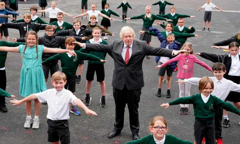 Boris Johnson joins pupils during a socially distanced visit to Bovingdon Primary School, Hemel Hempstead, Hertfordshire, on Friday.
