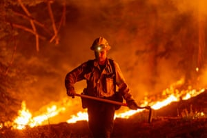 Los Angeles County firefighters, using only hand tools, keep fire from jumping a fire break at the Bobcat Fire in the Angeles National Forest on 11 September, 2020 north of Monrovia, California. California wildfires have already incinerated a record 2.3 million acres this year and are expected to continue till December. The Bobcat Fire has grown to more than 26,000 acres.