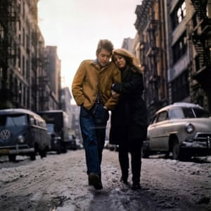 "Don HunsteinBob Dylan and Suze, New York, 1966 ""Well, I can't tell you why I did it, but I said, 'Just walk up and down the street.' There wasn't very much thought to it. It was late afternoon – you can tell that the sun was low behind them. It must have been pretty uncomfortable, out there in the slush."" Don HunsteinEst $2,000 - 3,000"