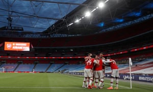Pierre-Emerick Aubameyang celebrates with teammates in a near-deserted Wembley Stadium, after scoring his team's second goal in Arsenal's 2-0 victory over Manchester City in the FA Cup semi-final match.