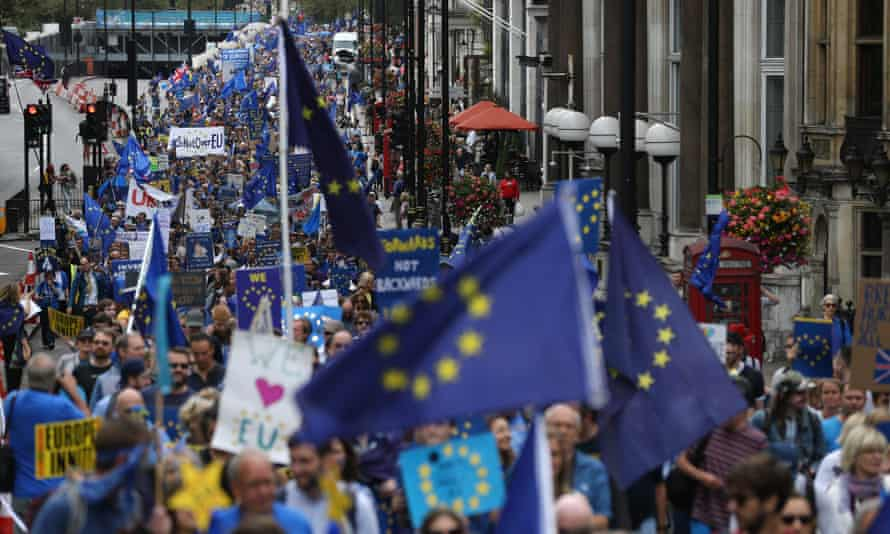 People march with EU flags and pro-Europe slogans on placards during a March for Europe protest against the Brexit vote.
