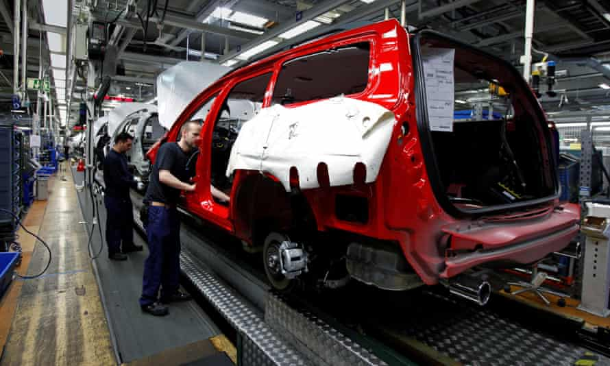 Workers assemble Volvo vehicles at the firm's Gothenburg factory.