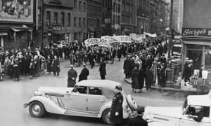 Supporters of the New Deal agency march through New York in protest at corporate layoffs, January 1937.