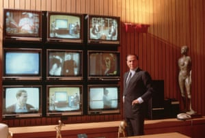 1986: Berlusconi the media tycoon poses in front of an array of televisions