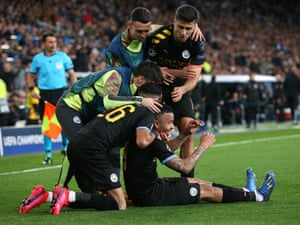 Gabriel Jesus is mobbed by teammates after scoring against Madrid