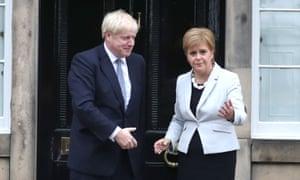 Nicola Sturgeon and Boris Johnson outside Bute House in Edinburgh.