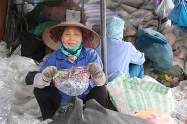 Nguyễn Thị Hồng Thắm is paid $6.50 a day to sort recycling on the outskirts of Hanoi.