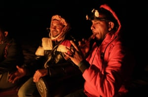 An Egyptian guide plays a flute at a camp